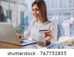 young woman holding credit card ...   Shutterstock . vector #767752855
