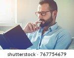 handsome man reading... | Shutterstock . vector #767754679