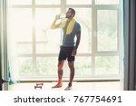 handsome sporty man resting ... | Shutterstock . vector #767754691