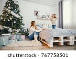 baby girl jumping on the bed... | Shutterstock . vector #767758501