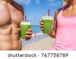 fitness couple drinking green... | Shutterstock . vector #767758789