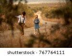 children walking along the road ...   Shutterstock . vector #767764111