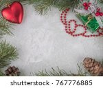 frame made of fir branches with ... | Shutterstock . vector #767776885