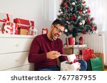 smiling young man is exciting... | Shutterstock . vector #767787955