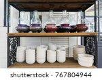 lantern and white bowl on shelf ... | Shutterstock . vector #767804944
