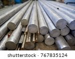 pile of metal rods. stainless... | Shutterstock . vector #767835124