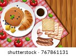 breakfast set on wooden table... | Shutterstock .eps vector #767861131