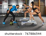 fitness trainer and girls doing ... | Shutterstock . vector #767886544