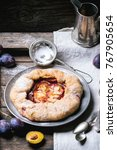 cake galette with plums  served ... | Shutterstock . vector #767905654