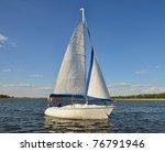 Single Sail Boat On The Lake....