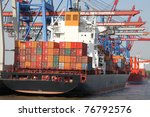 big container vessel in a container port - stock photo