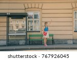 girl stopping a taxi on the... | Shutterstock . vector #767926045