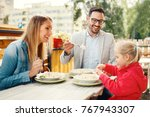 happy family is enjoying pasta... | Shutterstock . vector #767943307