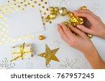 woman hold golden christmas... | Shutterstock . vector #767957245