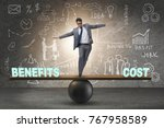 Small photo of Businessman balancing between cost and benefit in business conce