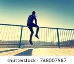 the runner in tall black... | Shutterstock . vector #768007987