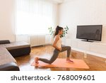 fit woman exsercise in the room ... | Shutterstock . vector #768009601