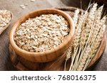rolled oats or oat flakes and... | Shutterstock . vector #768016375