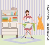 housewife ironing shirt on... | Shutterstock .eps vector #768026989
