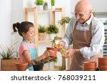 senior man gardening with his... | Shutterstock . vector #768039211