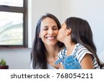 young daughter kissing mother... | Shutterstock . vector #768054211