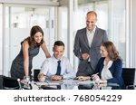 happy business team in a... | Shutterstock . vector #768054229
