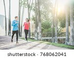 fitness young couple running... | Shutterstock . vector #768062041