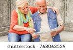 senior couple reading tourist... | Shutterstock . vector #768063529