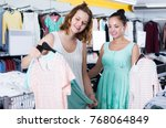 happy adult customers looking... | Shutterstock . vector #768064849