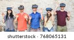 young students wearing virtual... | Shutterstock . vector #768065131