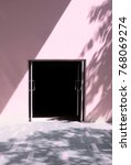 Small photo of Dark and empty doorway with light and shadow on pink pastel of building wall and pathway with grey ceramic tile confound with pink