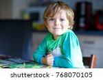 little blond kid boy playing... | Shutterstock . vector #768070105