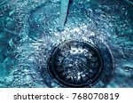 a stream of clean water flows... | Shutterstock . vector #768070819
