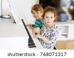 two little kids girl and boy... | Shutterstock . vector #768071317