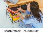 beautiful seamstress choosing... | Shutterstock . vector #768080839