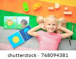 cute little girl with toys on... | Shutterstock . vector #768094381