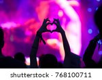 crowd at concert   heart shaped ... | Shutterstock . vector #768100711