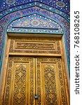 old wooden door decorated with... | Shutterstock . vector #768108265