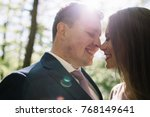stunning bride and groom are... | Shutterstock . vector #768149641