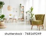 green velvet armchair standing... | Shutterstock . vector #768169249
