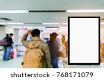 Small photo of vertical advertising billboard or blank showcase light box for your text message or media content with people at immigration control in the airport, commercial, marketing and advertisement concept