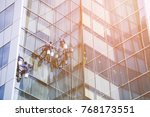 workers cleaning windows of a... | Shutterstock . vector #768173551