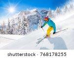 skier skiing downhill during... | Shutterstock . vector #768178255