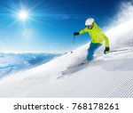 skier skiing downhill during... | Shutterstock . vector #768178261