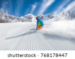 skier skiing downhill during... | Shutterstock . vector #768178447