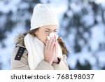 Woman Blowing In A Tissue In A...
