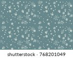 snowflake on winter gray sky... | Shutterstock .eps vector #768201049