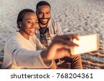 smiling young african couple... | Shutterstock . vector #768204361