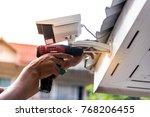 technician installing cctv... | Shutterstock . vector #768206455