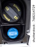 Small photo of Opened diesel fuel tank filler showing Ad Blue filling cap point on a VW transporter T6 Novemeber 2017